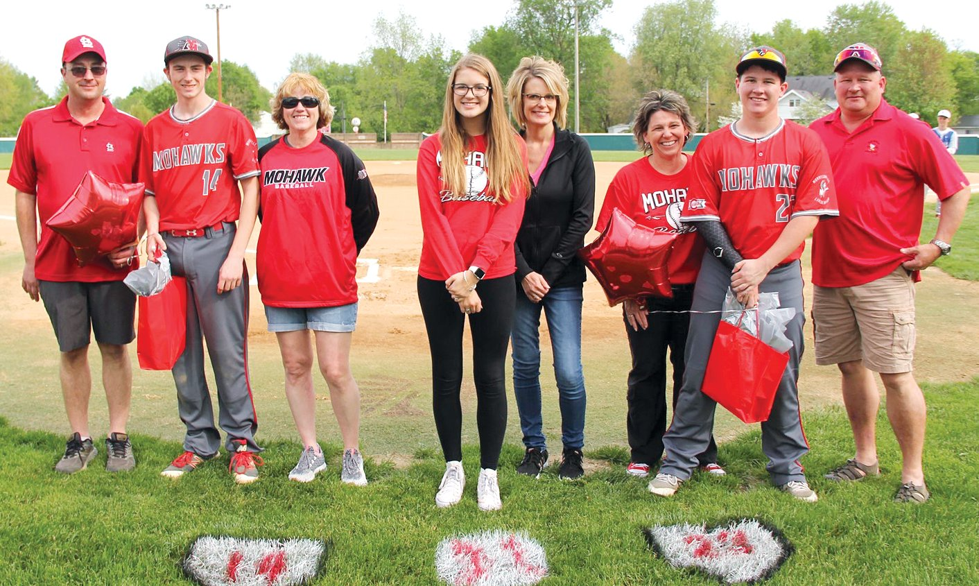 Three senior members of the Morrisonville/Lincolnwood baseball team were honored prior to the Mohawks' game on Tuesday, May 7, in Morrisonville. From the left are Andrew Skinner, with parents Danny and Rachel Skinner; Cameron Krager with mom Lori Krager; and Dade Pitchford, with parents Dana and Doug Pitchford.