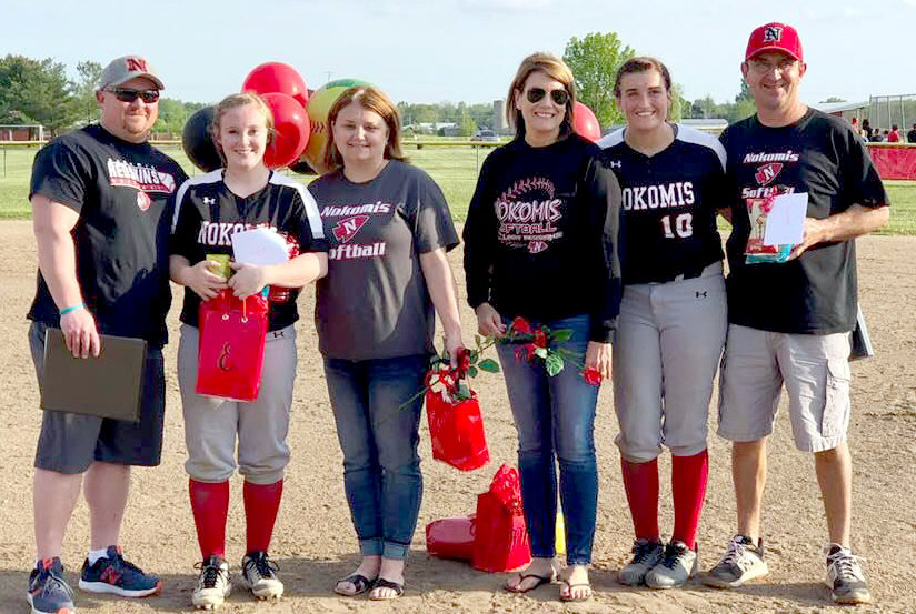 The Nokomis High School softball program honored its two seniors on Tuesday, May 7, prior to the Lady Redskins' home game against New Berlin. From the left are Emily Cesaretti, with parents Gabe and Kristy Cesaretti, and Madelyn Sowarsh, with parents Bonnie and Mark Sowarsh.
