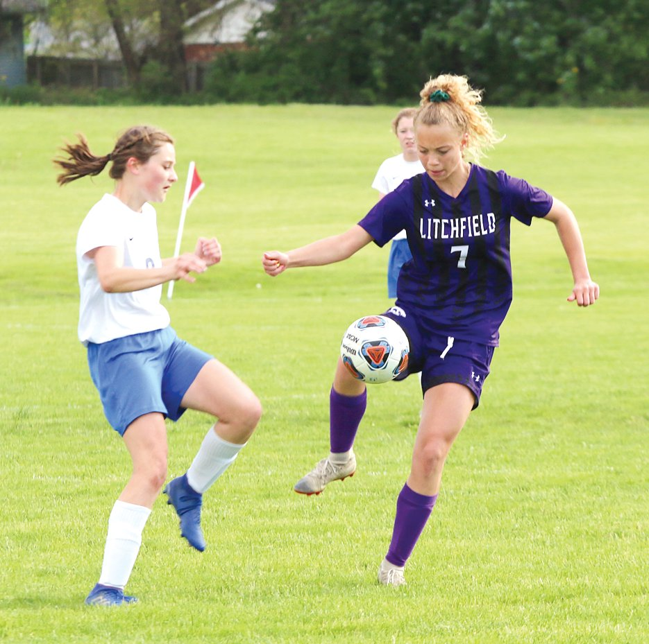 Litchfield's Izzy Ray gains control of a ball near mid-field during the Lady Panthers' regional championship game against Auburn on Friday, May 10. Ray and the Panthers would get a late goal to score a 2-1 win over the Trojans and advance to Wednesday's sectional semifinal in Litchfield.