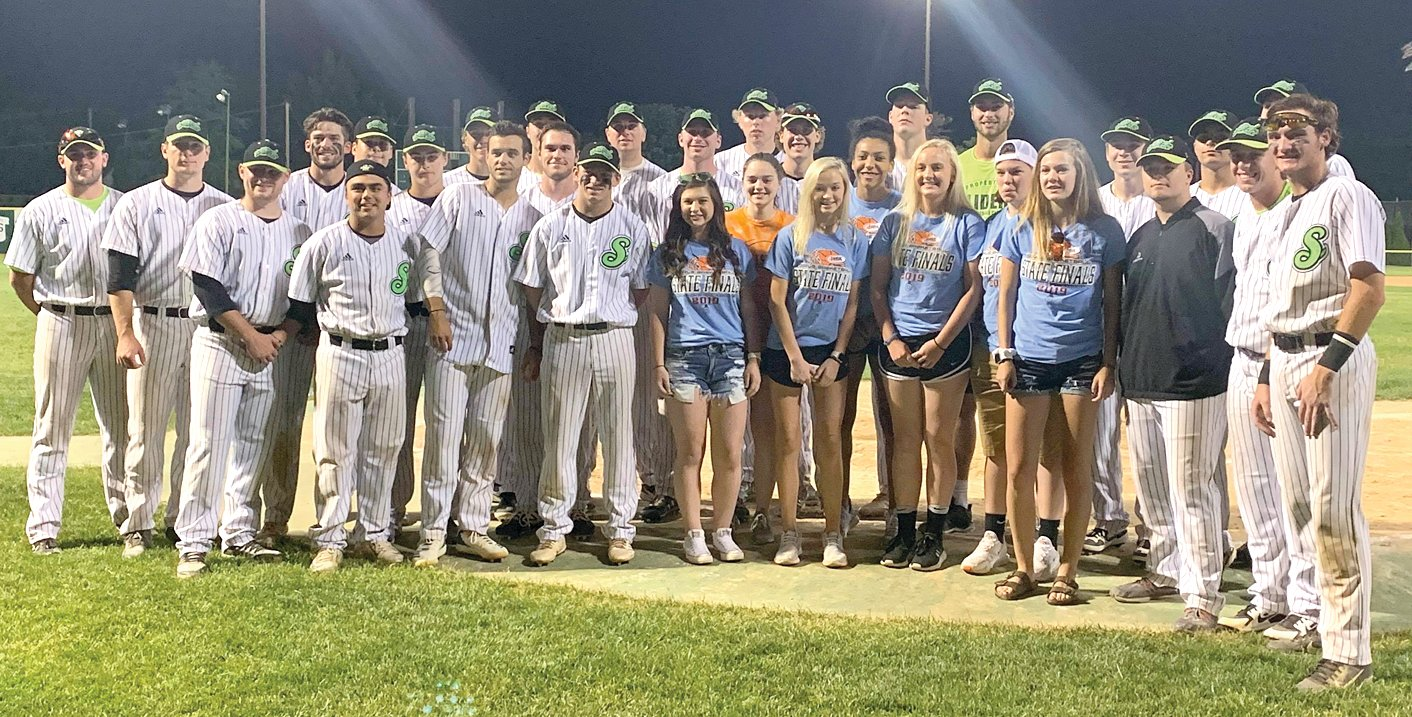 The 2019 Hillsboro Lady Hiltoppers pose for a picture with the Springfield Sliders following the Sliders' game against Normal on Tuesday, June 4. The team was honored prior to the game in celebration of their fourth place finish at the IHSA Class 2A State Finals this past season. Hillsboro players, from the left, are Sheridan Lyerla, Jade Scroggins, Maddy Rupert, Nikya Harston, Claire Tester, Aubry Rupert and Kylie Meier.