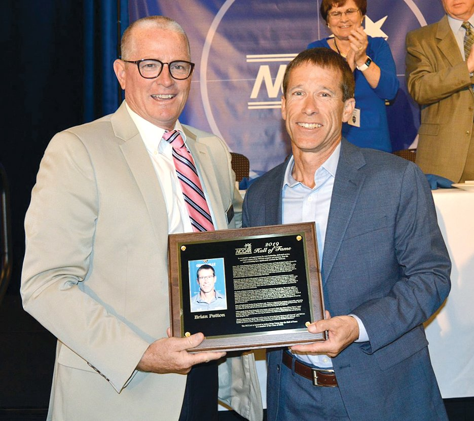 Brian Patton of Hillsboro, at right, was inducted into the NCCAA Hall of Fame on May 30, in Greenville, SC. He is pictured with Dan Wood, director of the National Christian College Athletic Association.