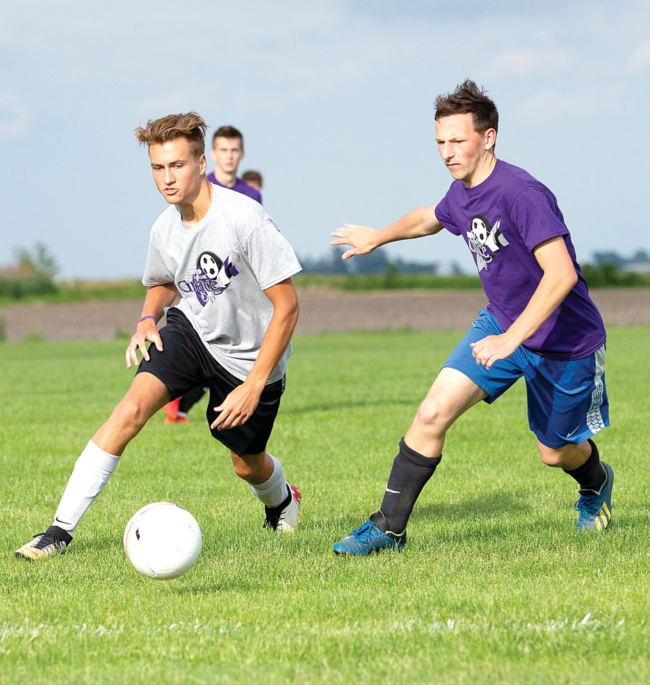 Riverton's David Haage (in purple) tries to track down Noah Birk of Staunton during the Grace Cup on Saturday, June 8, in Raymond. Birk had the Gray team's lone goal in the Purple team's 3-1 win.