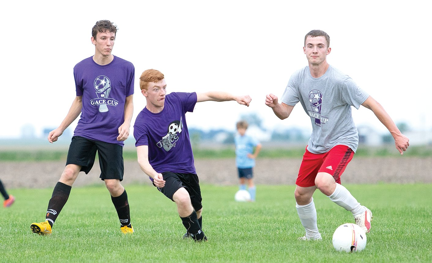 First Baptist Christian Academy's Nathan Bailey (left) and Nokomis' Brenden Applegate (center) try to track down Devan Martincic of Tri-City during the Grace Cup on Saturday, June 8, at Terry Todt RHSA Field in Raymond. The fifth annual all-star soccer game brought together 48 players from 15 different schools, ranging from north of Springfield to the Metro-East.