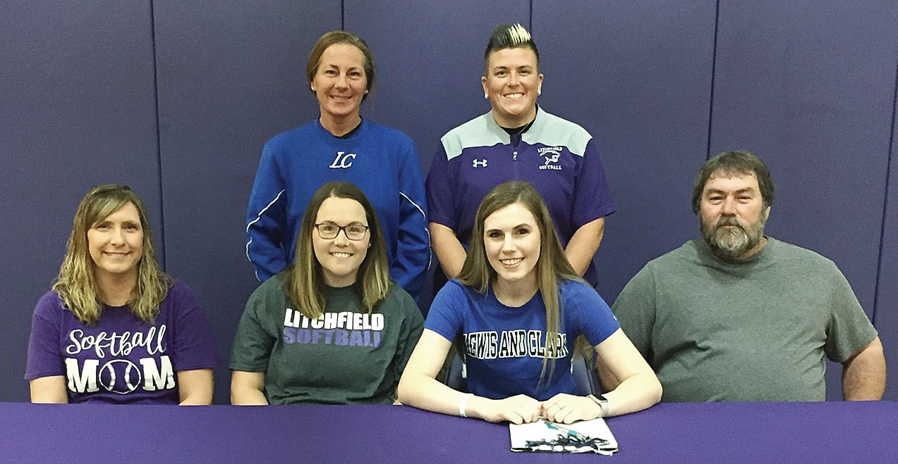 On Thursday, May 23, Litchfield High School senior Lizzy Luttrell, signed her letter of intent to play softball for Lewis and Clark Community College this coming season. In front, from the left, are Jeanette, Stephanie, Lizzy and Steve Luttrell. In the back are Lewis and Clark Head Softball Coach Ronda Roberts and Litchfield High School Head Softball Coach Jessica Ball.
