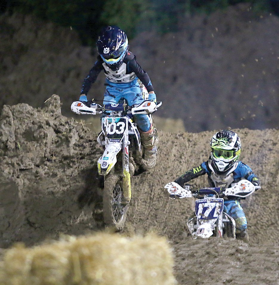 Travis Lentz (171) of Walshville pulls slightly ahead of Cooper Duff (103) of Donnellson during their race in the 65 open at the Montgomery County Fair on Friday, June 21. Lentz went on to win both races and take the over title in the class.