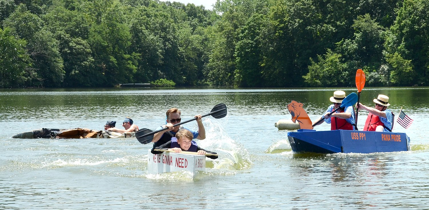 Hughes Pfeiffer of Edwardsville and his dad, Travis, in the center, paddled their way into first place at this year's fifth annual Imagine Hillsboro Cardboard Boat Regatta. Other boats in the championship flight, included Griffin Wright and Dawsen Loafman, at left, and Jack Nollman and Tom Dean of Pana, at right. The Pana Pride team took home the award for Most Creative entry.