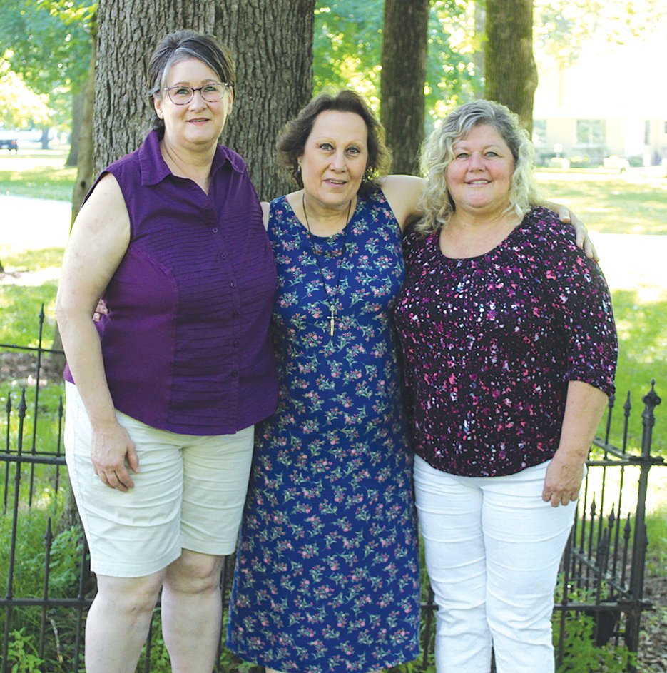Three of five local women who coordinated the new Girls In Action organization and are excited to serve the surrounding community, from the left, are Kim Doolin, Elizabeth Apps and Sandy Adams.