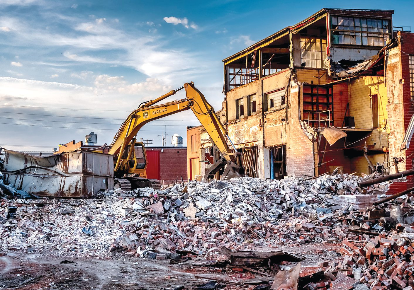 One of the excavators used by Glynn Demolition tears through the back end of the former Litchfield Creamery Building. Hopes are high that the site will be given new life over the next few years, with plans for a recreation center underway.