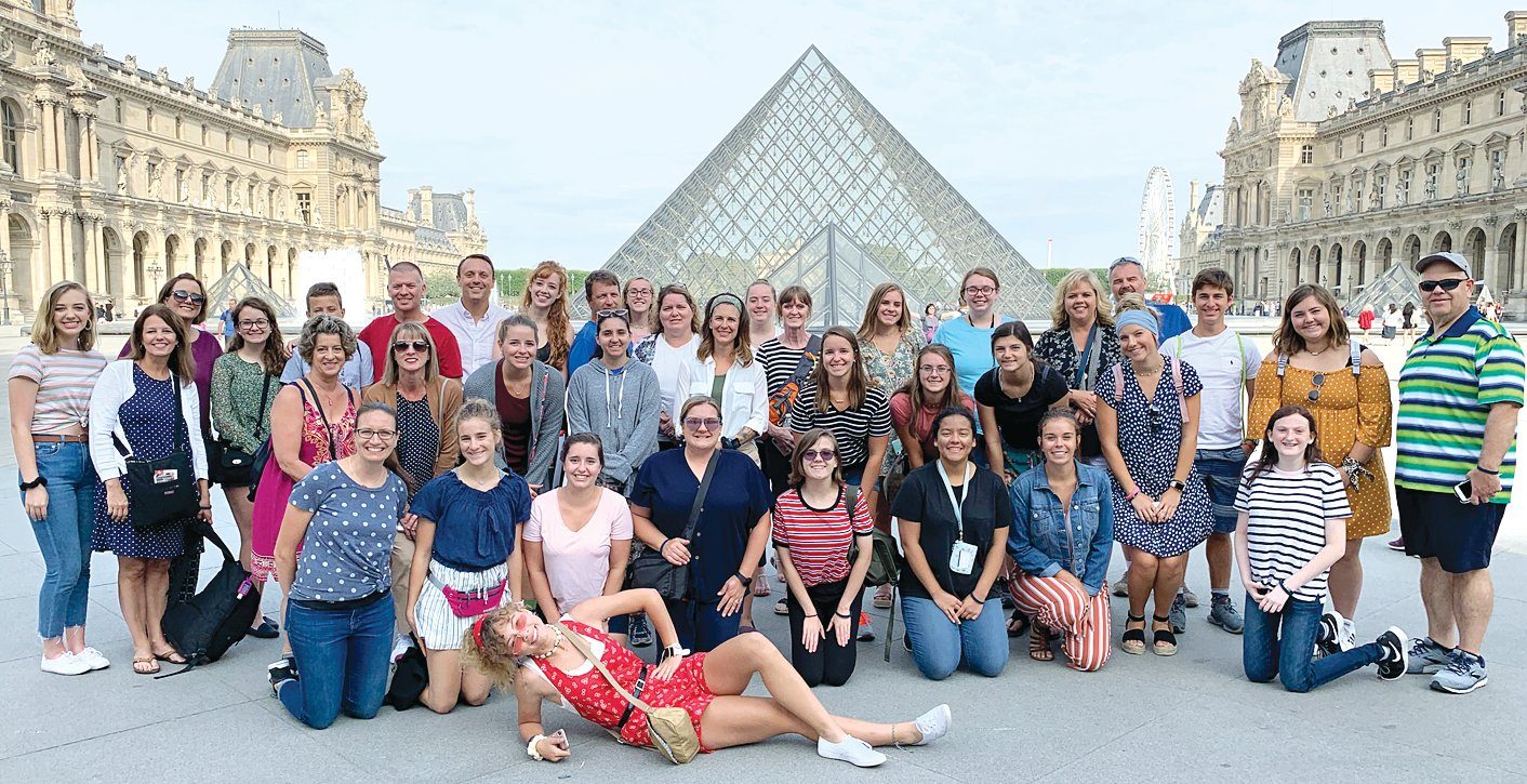 The Litchfield travelers in front of the Louvre in Paris.