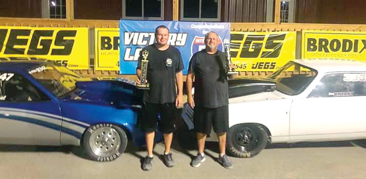 Dustin Bryant (left) shared victory lane with father, Phil Bryant, on Saturday, July 27, as the pair won the footbrake and super pro classes respectively at I-57 Dragstrip in Benton.
