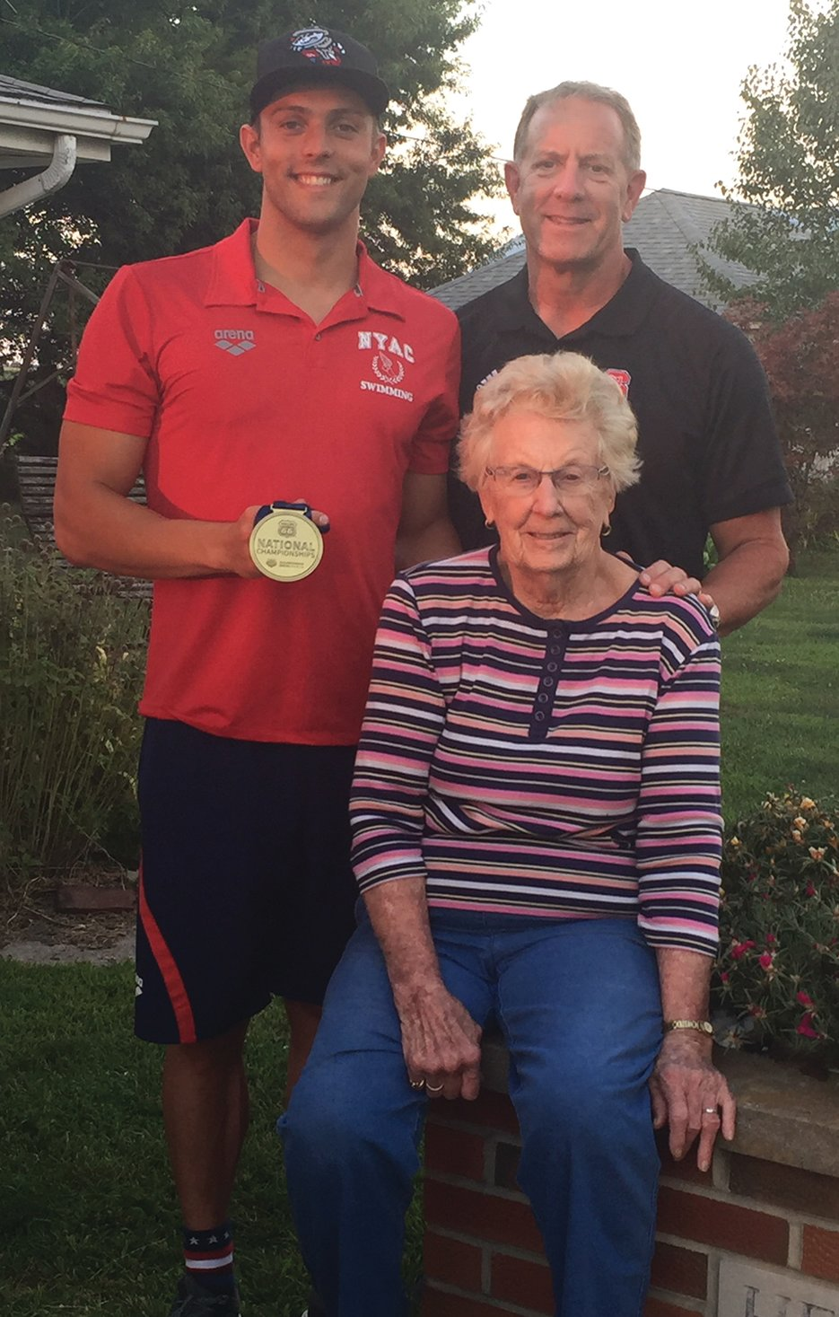 Following a successful championship, Ryan Held of Springfield paid a special visit to his grandmother, Marge Held, in Raymond. Pictured above with Held and his grandmother is his father, Randy Held.