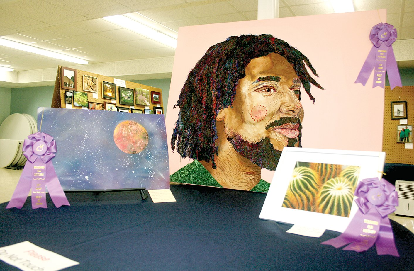 "The stunning work of three local artists took Best of Show awards for pieces exhibited in the 2019 Old Settlers Art Show. From the left is  Abigail White's painting ""Deep Space,"" Heather Hampton+Knodle's photograph ""Prickly Peace"" and  Sarah Ginnard's piece ""His Name is Nahm."""