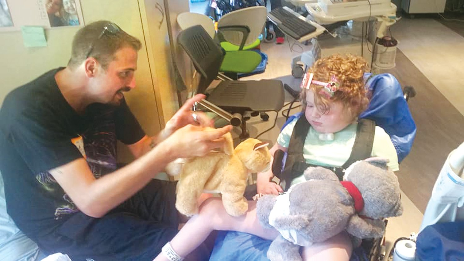 Seven-year-old Lilly Hackworth of Morrisonville is pictured above with her father, Guy Hackworth, as they play with stuffed animals at Ranken Jordan Pediatric Bridge Hospital in Maryland Heights, MO, where Lilly has been receiving care this year.