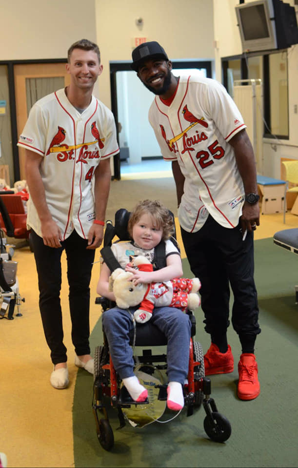 Just four days before her seventh birthday, Lilly Hackworth and her friends at Ranken Jordan Pediatric Bridge Hospital were paid a special visit by St. Louis Cardinals Pitcher Chasen Shreve and Right Fielder Dexter Fowler on Tuesday, July 16. Chasen and his wife Shannon, Fowler and Build-A-Bear joined together to bring lots of smiles and bears to youngsters who are currently undergoing treatment for complex medical needs and are transitioning from the hospital to home. The visit came just before the Cardinals were defeated by the Pittsburgh Pirates in a 3 to 1 game. Hackworth is the daughter of Guy and Ariel Hackworth of Morrisonville. Ranken Jordan Pediatric Bridge Hospital is located in Maryland Heights, MO.