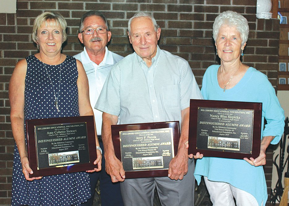 The Hillsboro Education Foundation presented its Distinguished Alumni Award as part of its Old Settlers reception on Thursday, Aug. 8, at Mulligan's Lakeside Restaurant at the Hillsboro Country Club. Pictured in front, from the left, are award winner Amy (Cobetto) Stewart, Hillsboro Education Foundation President Gene White, and award winners Dr. Jerry Parola and Nancy (Bliss) Slepicka.