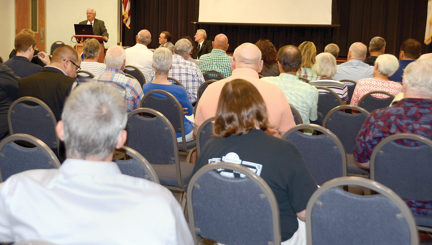 Dr. Bill Phillips addresses a crowd of about 100 local residents during a presentation of the school reorganization study on Monday evening, Aug. 12, at Lincoln Land Community College in Litchfield.