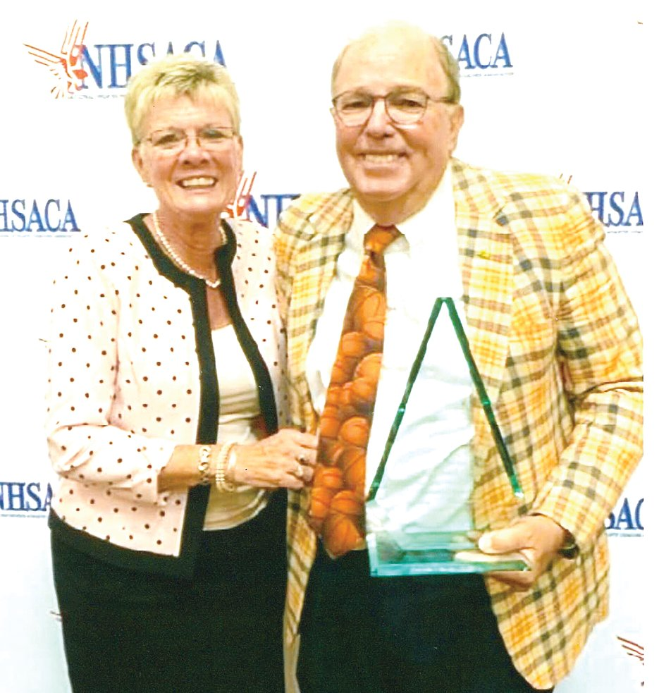 On June 26, John Harder, pictured with wife, Rhonda, earned the National High School Athletic Coaches Association Coach of the Year in girls basketball after 905 wins and three state titles in 45 years. Before becoming a legend at Southeast High School in Bradenton, FL, Harder was a football and basketball coach at Litchfield and Mt. Olive in the late 1970s.