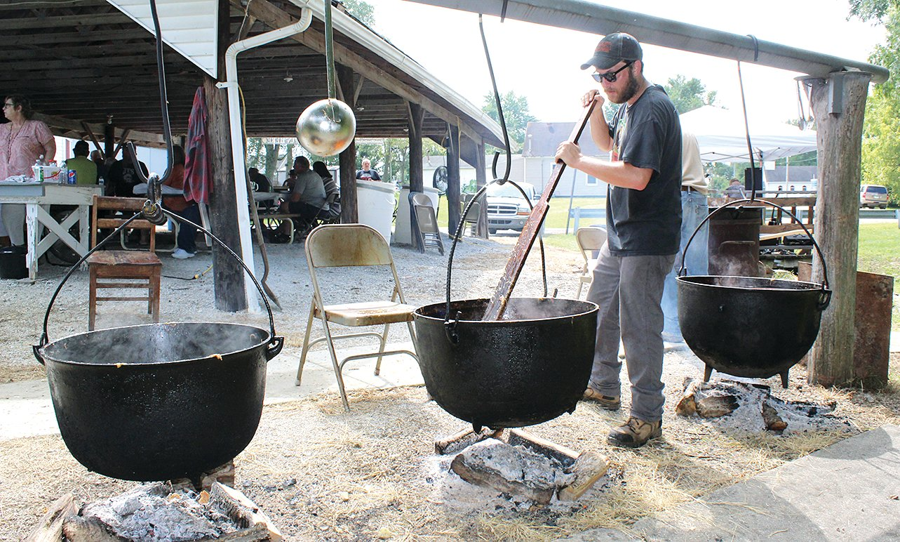 Many people from in and around Panama gathered together on Sunday, Sept. 1, at the VFW Hall for the annual mulligan, a soup which consists of beef or turtle and vegetables. In the photo above, Cory Parnell stirs one of the pots of soup.