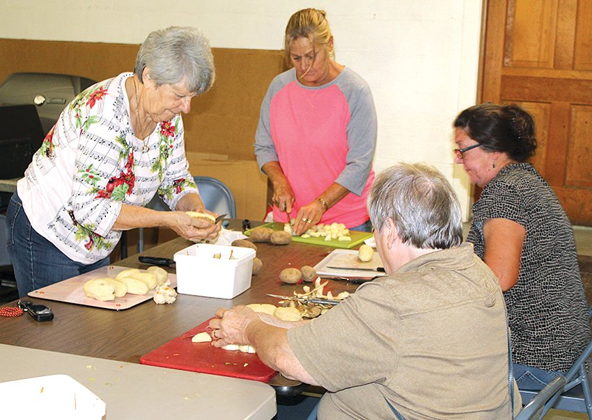 Volunteers gathered in the Panama VFW Hall basement on Saturday morning to cut the vegetables for Sunday's annual mulligan. Pictured above, from left to right are Sally Spensberger, Kim Lappie,Karen Vohlken and Jeannette Manning.