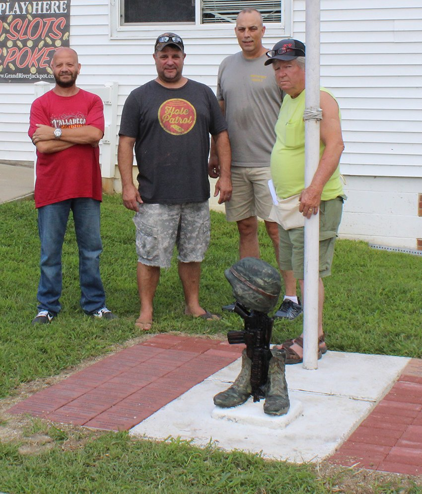 During the annual mulligan, the VFW Hall unveiled their new project which stands out front. The project features a statue of a pair of boots, a gun and a helmet, surrounded with bricks with veterans names on them. Pictured above, from left to right are Jim Osborn, Randy Thacker, Mark Reynolds and Lenny Earnest.
