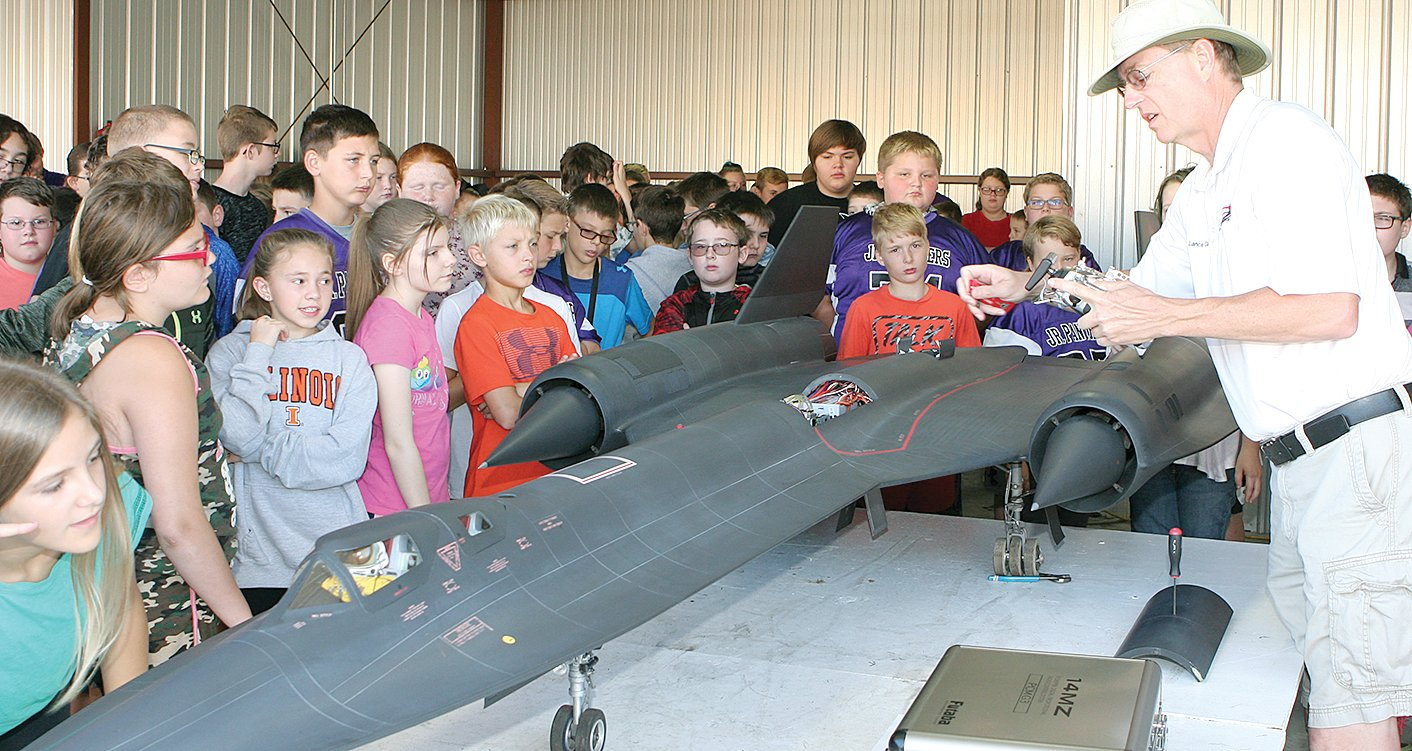 Lance Campbell of Columbia, MO, starts the electrical systems in his model SR-71 Blackbird in front of enthusiastic sixth grade students Friday morning at Roger Shipley's RC Jet Rally in Litchfield.