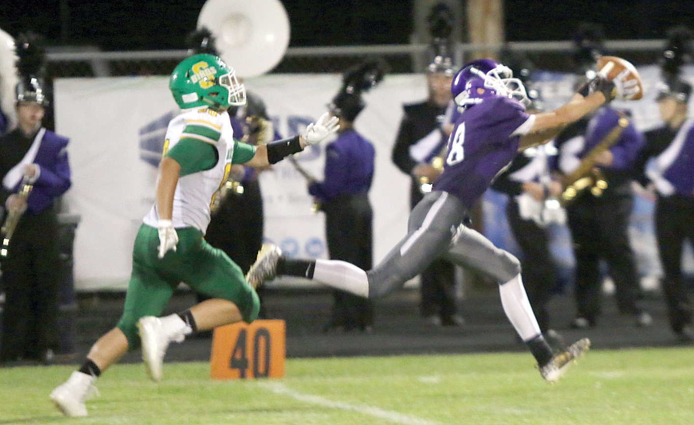 Litchfield receiver Colin Becker hauls in a 40-yard pass from Clayton Walch to set up the Panthers' first touchdown, a 30-yard pass that also went to Becker. The Panthers also scored in the fourth quarter, but Southwestern rolled to a 54-12 victory at Lloyd Hill Field in Litchfield on Friday, Sept. 13.
