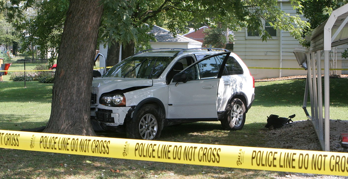 A neighbor called 911 after an alleged shooting victim crashed into a tree in a yard near the intersection of Fairground and Seymour in Hillsboro Friday morning.
