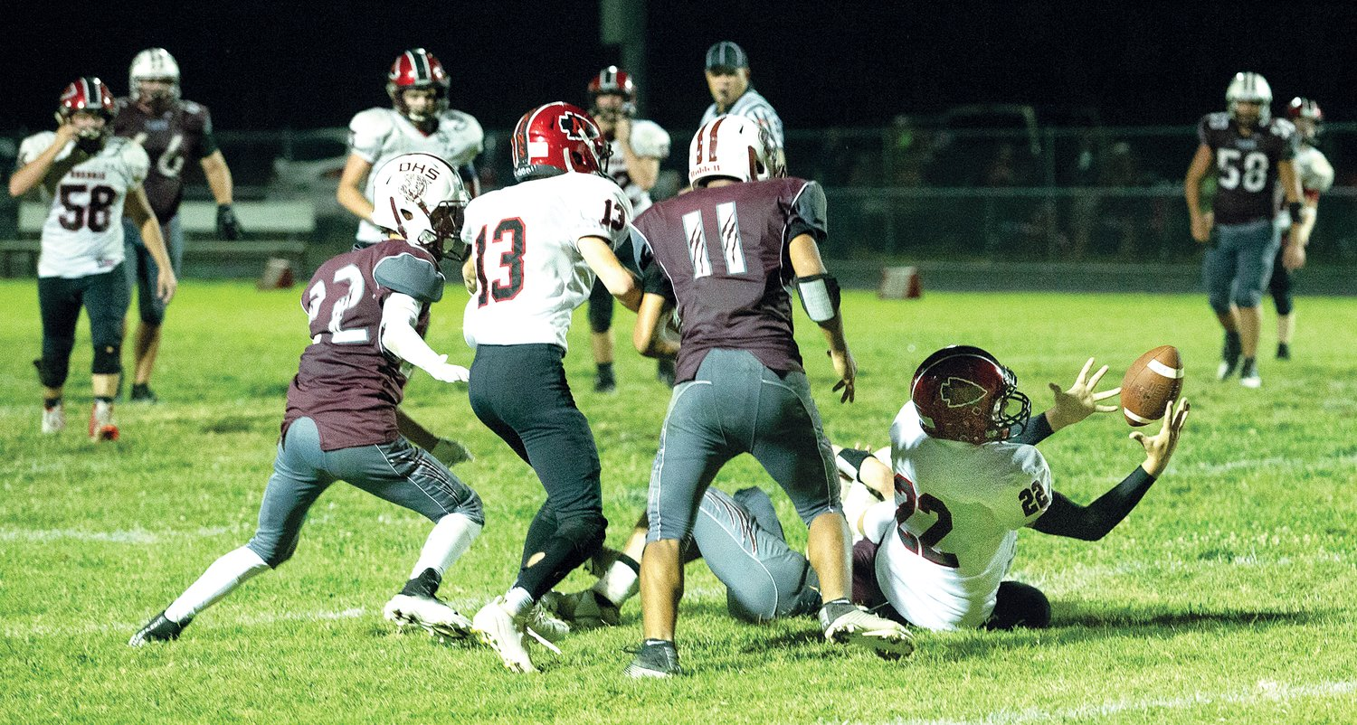 Nokomis' Cooper Bertolino (#22) was in the right place at the right time to catch Alex Tosetti's pass during the Redskins' 35-14 win over Dupo on Friday, Sept. 20.