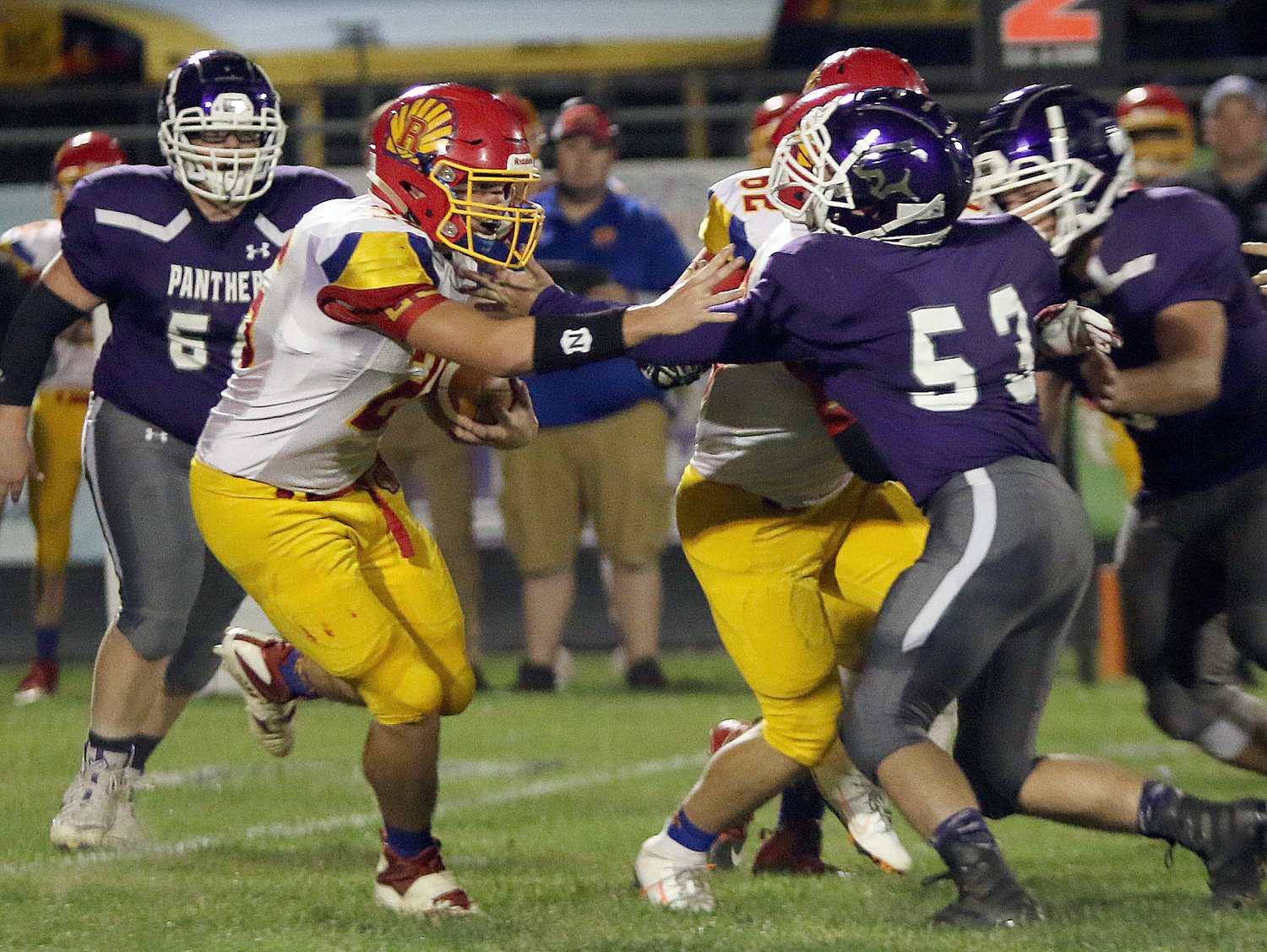 Litchfield's Hunter Niemann (53) tries to break free from his blocker to bring down Roxana's David Pluester during the Panthers' homecoming game on Friday, Oct. 4. The Shells would score 33 points in the first quarter en route to a 47-14 victory in Litchfield.