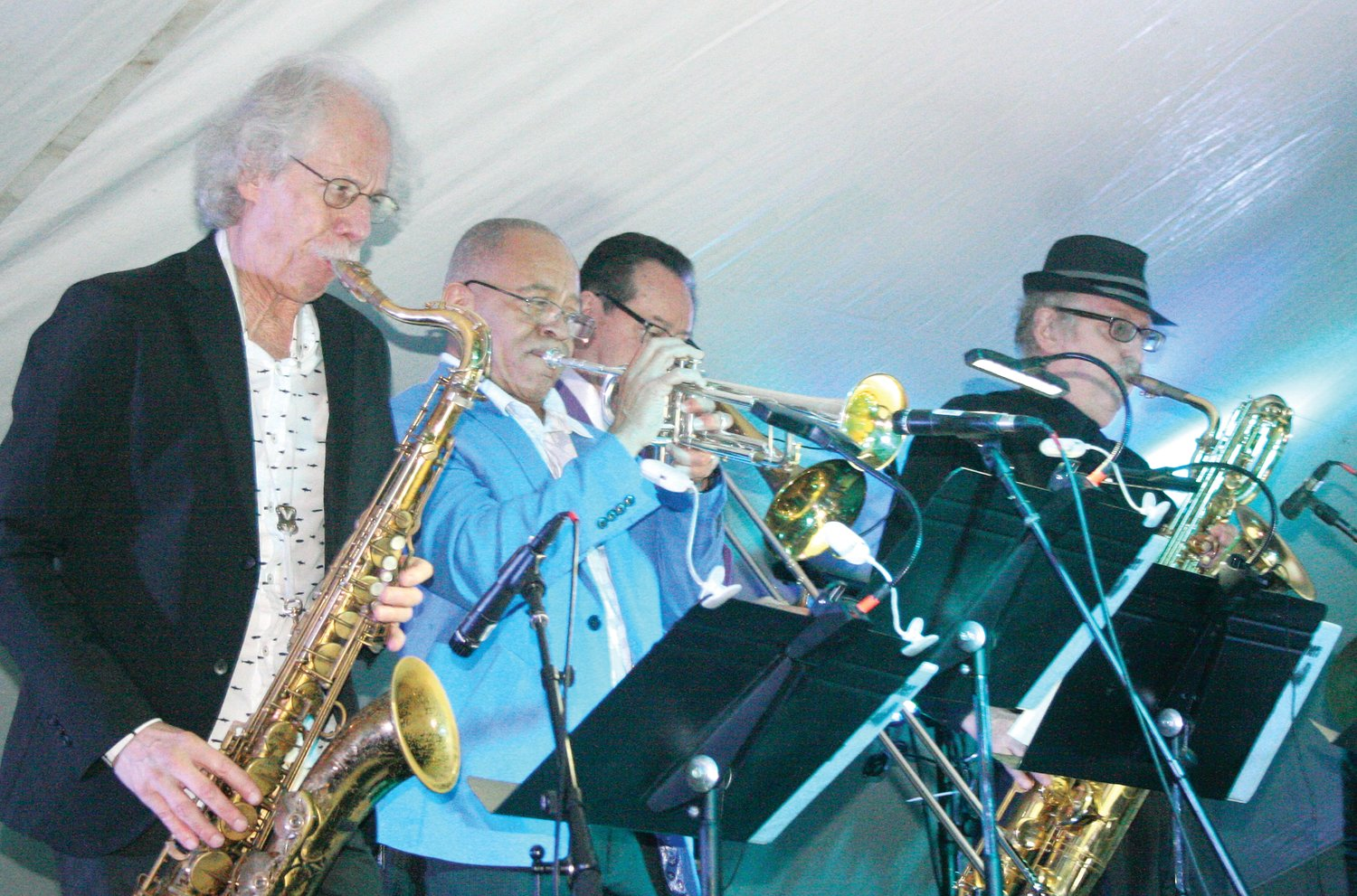 "Possibly the best horn section ever assembled for any band, backed up the Robinson Brothers at their Homecoming Concert.  ""Blue Lou"" Marini, left, on tenor sax, Bobby Burns, trumpet, Tom ""Bones"" Malone, and Doc Kupka on baritone sax, all famous in their own right, made the evening's performace stellar."