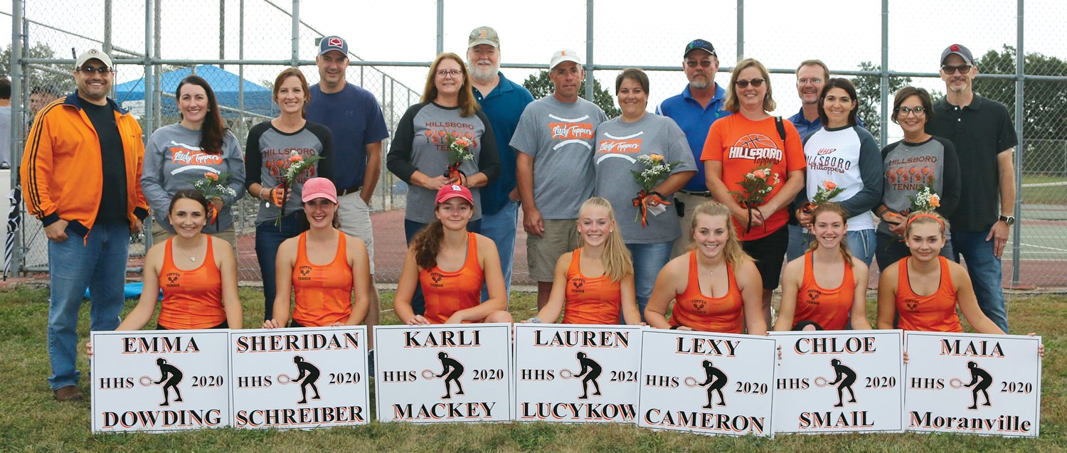 The Hillsboro girls tennis team honored seven of its seniors on Thursday, Oct. 10, before rain washed out the Lady Hiltoppers' match with Shelbyville. From the left are Emma Dowding, with parents Peter Dowding and Megan Cady; Sheridan Schreiber, with parents Chris and Kerry Schreiber; Karli Mackey, with parents Pam and Kelly Mackey; Lauren Lucykow, with parents Chuck and Kim Lucykow; Lexy Cameron, with parents Clark and Stacy Cameron; Chloe Smail, with parents Donovan and Carrie Smail; and Maia Moranville, with parents Niki and Mark Moranville.