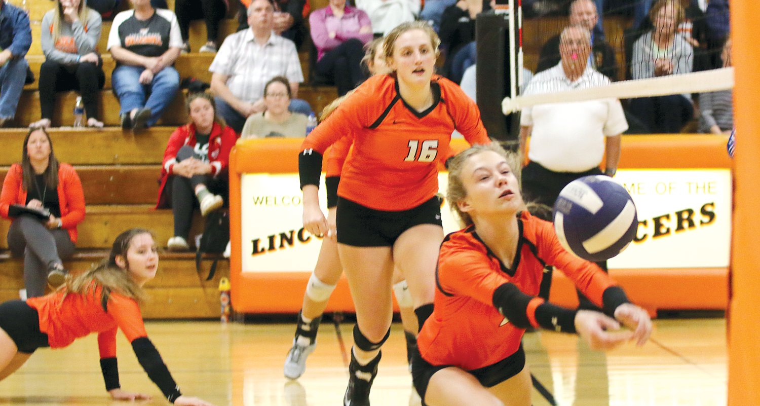 Lincolnwood's Avery Pope lunges to keep the ball alive, while teammates Cassie Krager and Katelyn Payne (#16) look on during the Lancers' game against Pawnee on Monday, Oct. 21. The Lancers would go on to beat the Indians in their regular season finale in three games, improving their record to 26-8-1 on the season.