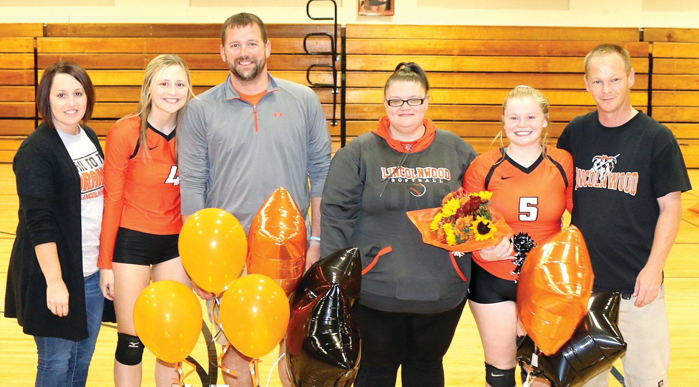 Lincolnwood seniors Madison Krager (#4), with parents Jill and Mark Krager, and Kyra Shull (#5), with parents Nichole and Charles Shull, were honored prior to the Lancers' home finale against Pawnee on Monday, Aug. 21. Both players have been a part of the Lincolnwood volleyball program since sixth grade. After graduation, Krager plans to attend Lincoln Land Community College, then transfer to SIUE to study early childhood education, while Shull plans to get her BSN license and further her education with a specialty in radiology or pediatrics.
