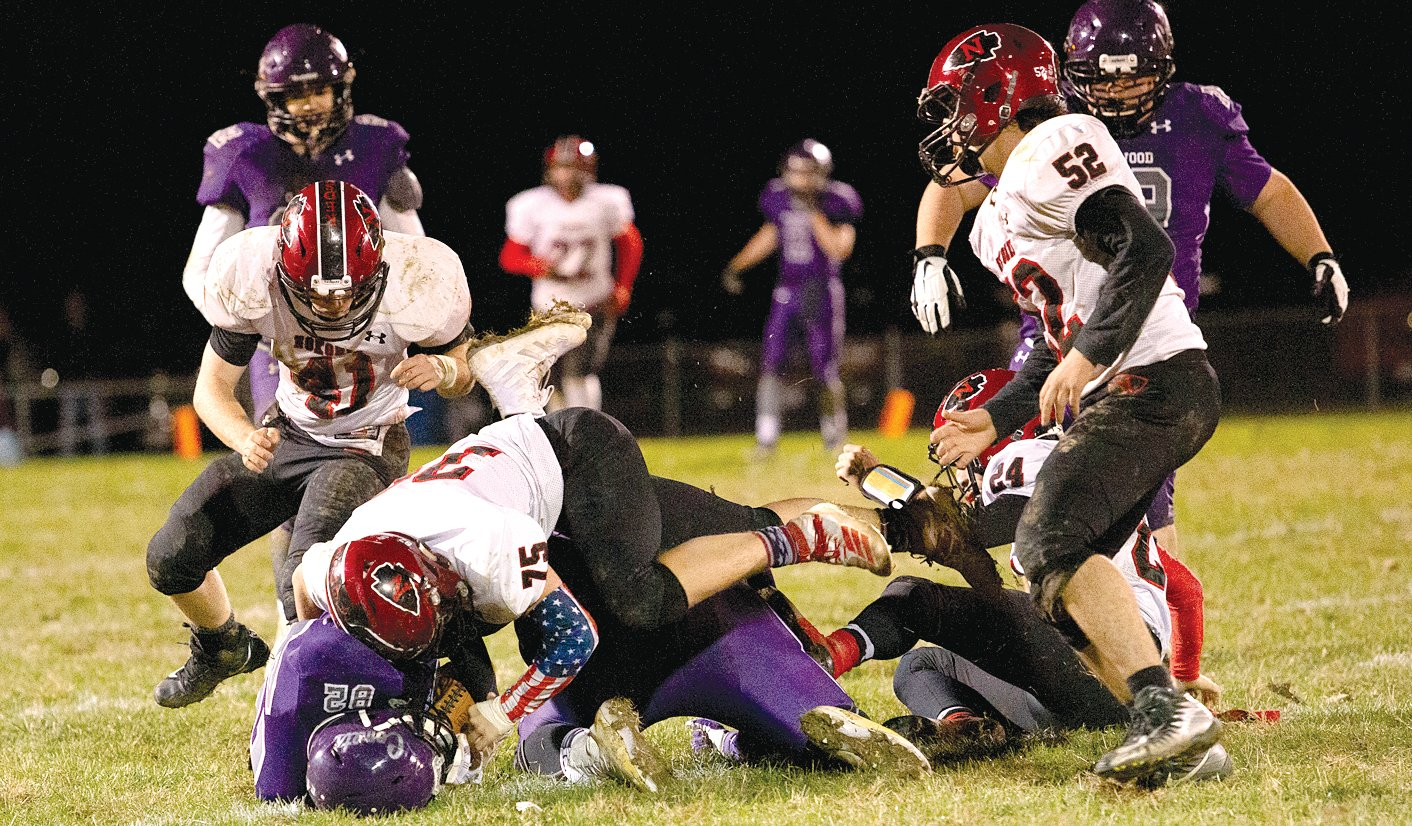 Nokomis' Quentin Jamieson (#75) brings down Oakwood's Bryce Harrison during the Redskins' first round playoff game in Fithian on Friday, Nov. 1. In a battle of two hard-hitting defenses, the Comets advanced to the next round of the playoffs against Pana with a 20-0 victory over the Redskins.