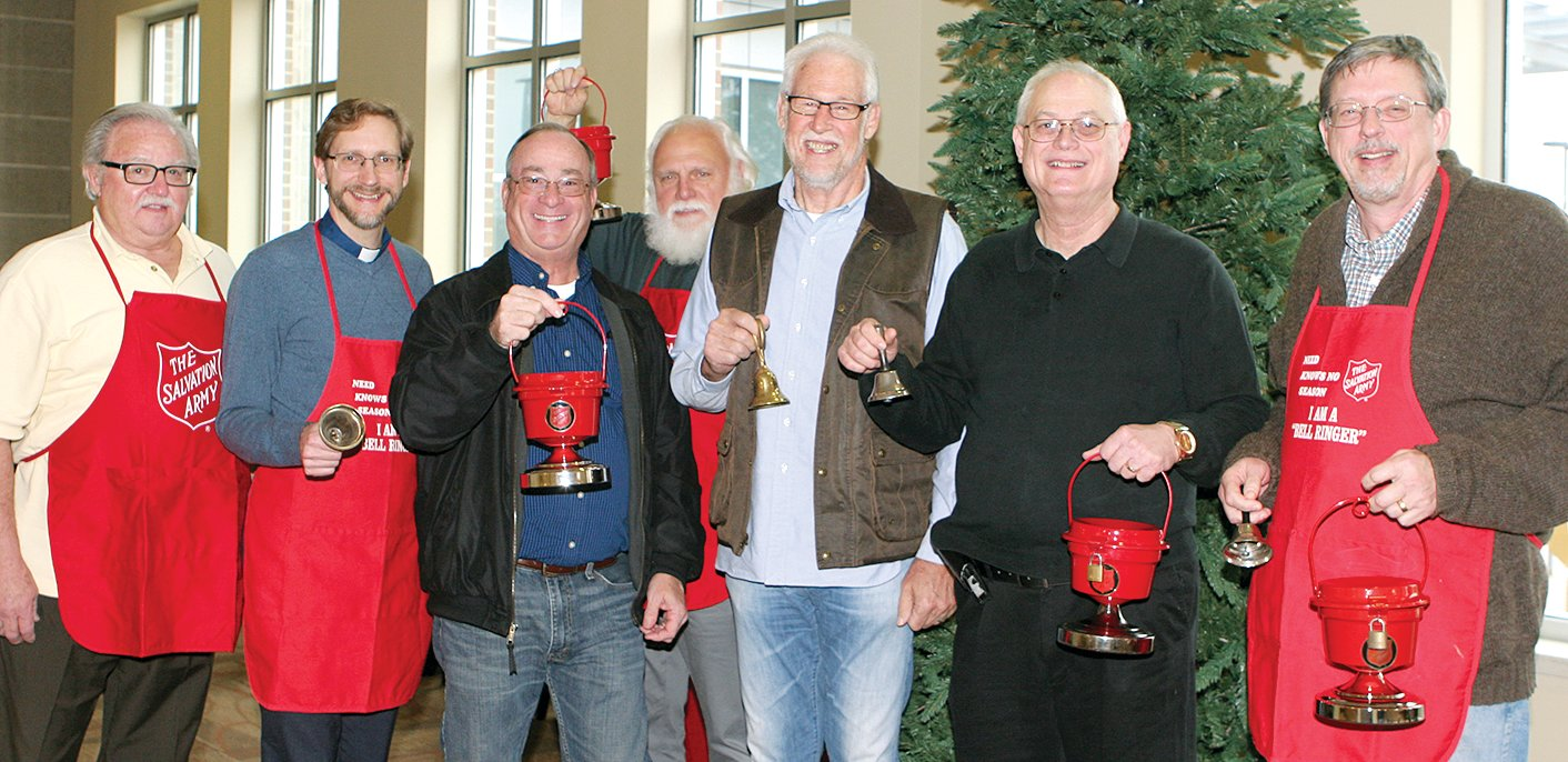 Ready to collect donations for The Salvation Army, from the left are Red Kettle coordinator Don Hudelson, and from the Hillsboro Ministerial Alliance are Pastor Stefan Munker, Pastor Randy Sands, Pastor John Jaffrey, Pastor Michael Lawton, Paster Jeff Hemken and Pastor Matt Ferguson.