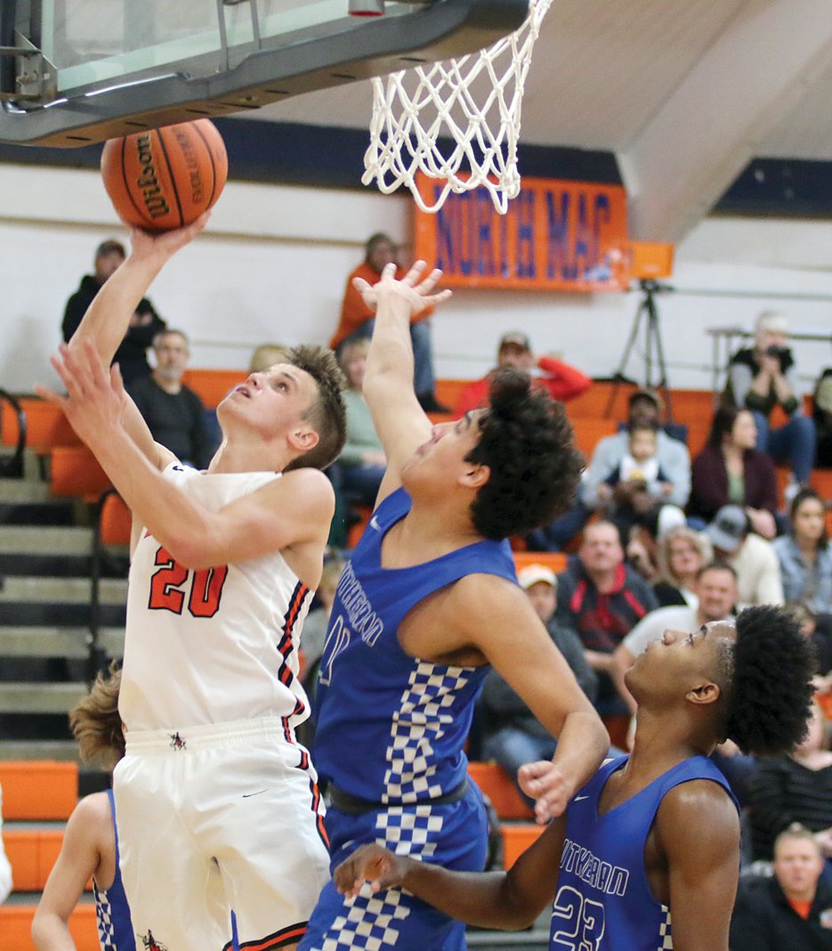 Shawn Goebel of Lincolnwood (via Morrisonville) goes up for two of his 11 points in the Lancers' 47-33 win over Springfield Lutheran on Friday, Nov. 29, at the Gene Bergschneider Turkey Tournament. Goebel would be named to the ten-player all-tournament team after Saturday's final game in New Berlin.