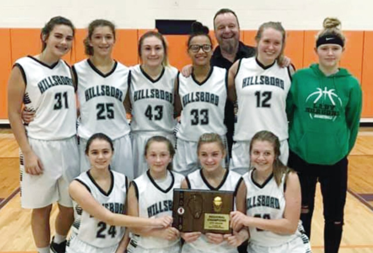 The Hillsboro eighth grade regional champions, in front from the left, are Annabelle Wright, Mckenzie Raymond, Kinley Richardson, Sophia Blankenship. In the back row are Addison Lowe, Tatum Christian, McKenna Carter, Coach Kenny White, Aubrey Evans and Tyler Beard.