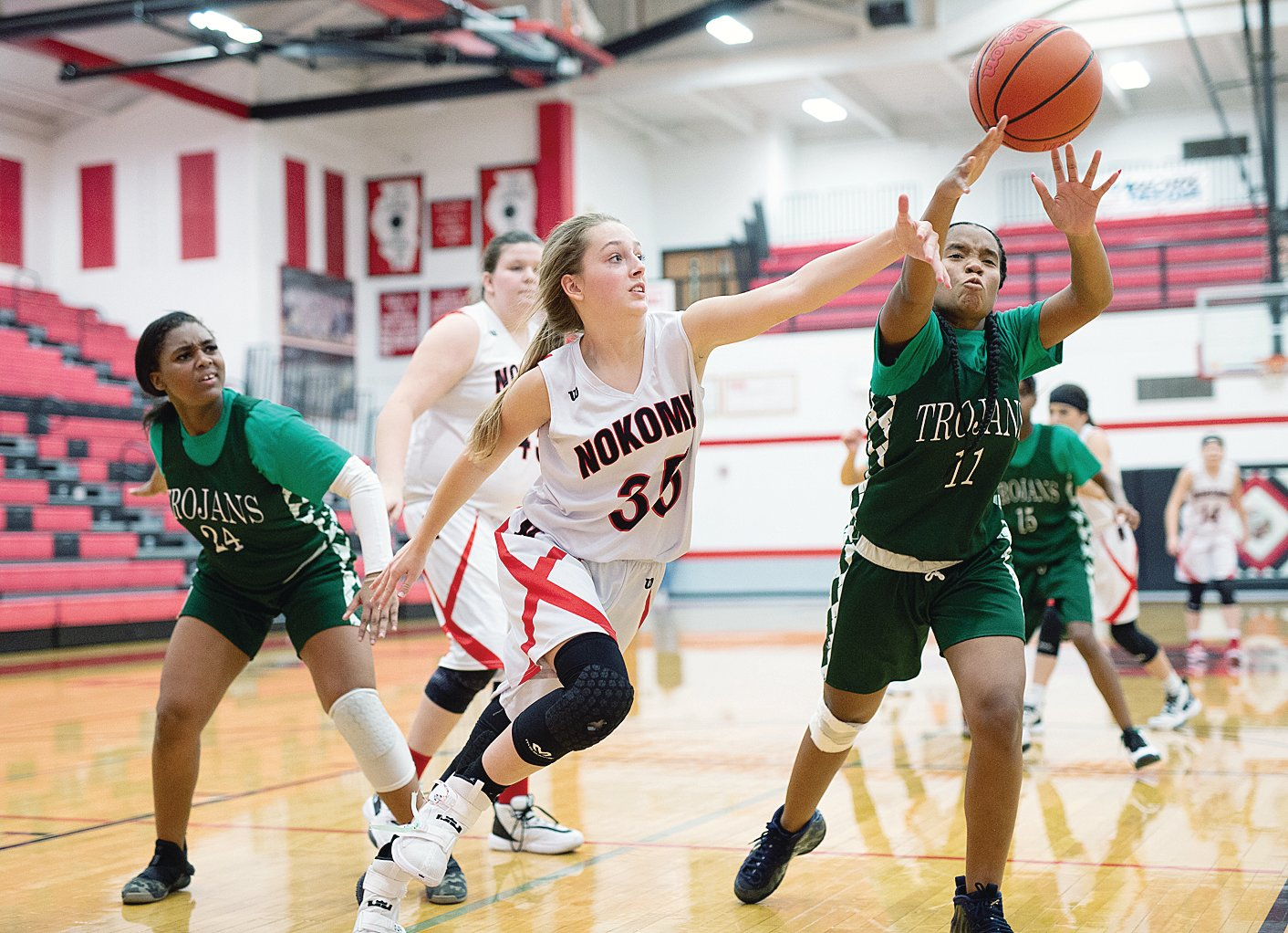 Nokomis' Emily Cress lunges for a loose ball during the Lady Redskins' 64-14 win over Madison on Thursday, Dec. 5. The Redskins followed that win with another against Metro-East Lutheran on Dec. 9,by a 37-35 final score, to improve to 4-5 on the season.