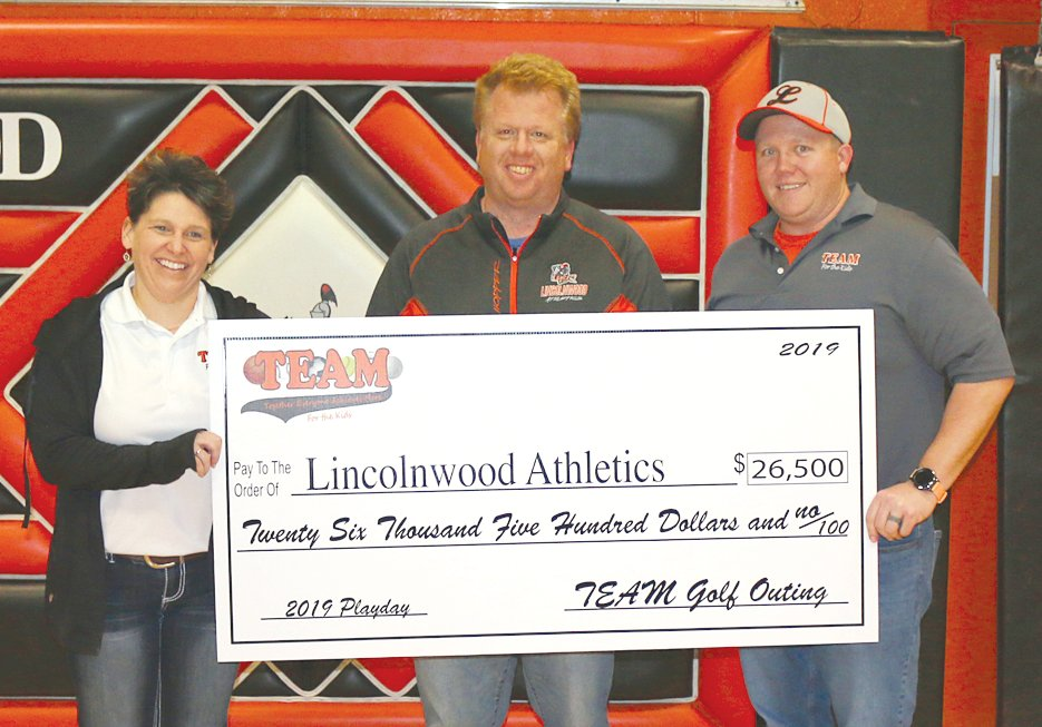 The TEAM Golf Outing Committee presented a check for $26,500 to Lincolnwood athletics on Saturday, Dec. 20, proceeds from the sixth annual event held in memory of late Lincolnwood principal Chad Langheim. From the left are Dana Pitchford, Panhandle Superintendent Aaron Hopper and Lincolnwood Athletic Director Josh Stone.
