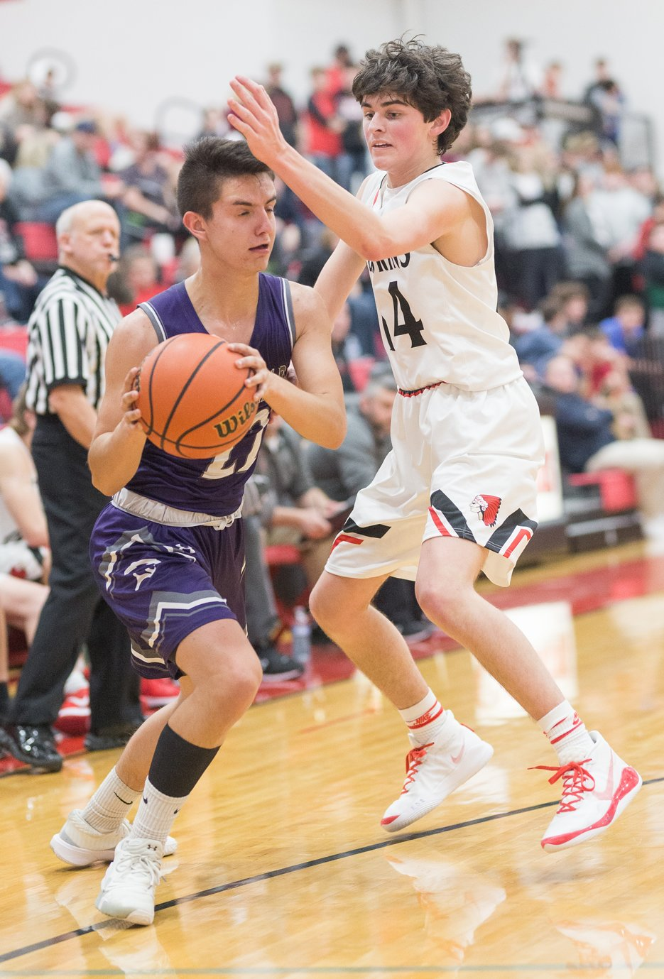 Litchfield's Blake McGill looks for a way around the defensive pressure provided by Nokomis' Seth Johnson during the Purple Panthers' 39-24 loss to the Redskins on Tuesday, Jan. 7.