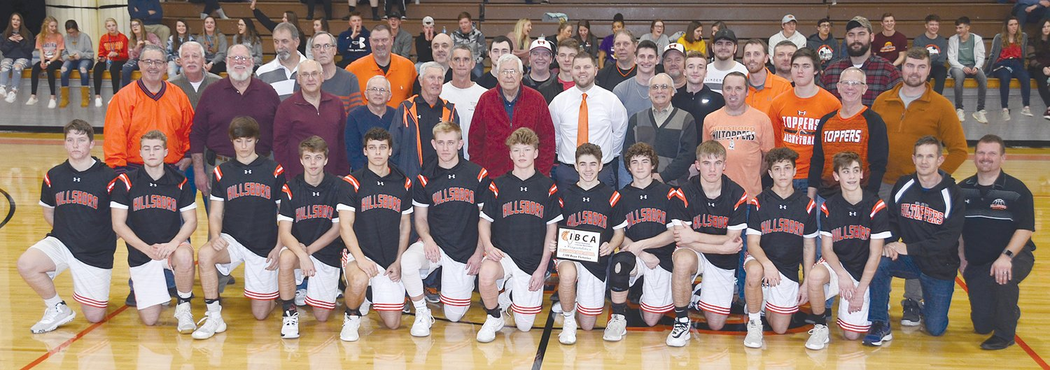 With the current crop of Hiltoppers in front of them, more than 30 ex-Hillsboro basketball players and coaches hit the floor once again to celebrate the program's 1,500th win, which occurred last year against Ramsey.