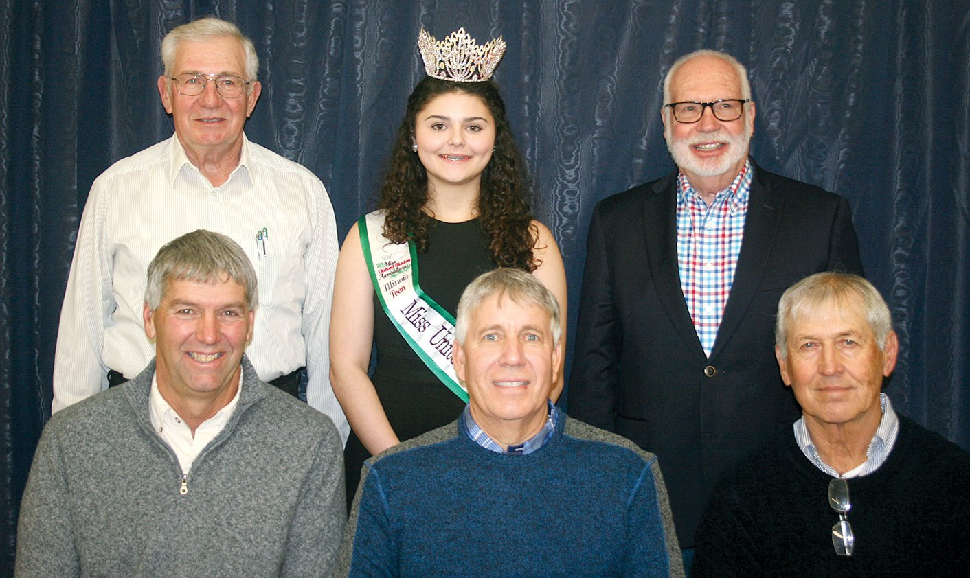 In front, from the left, are board members Dennis Hand, Dave Schluckebier and Dave Pastrovich. In back, from the left, are board member Ken Suslee, Teen Miss Illinois United States Agriculture Elaan Bader and Associate Director Dick Lyons. Not pictured are Chairman Jason Anderson and Associate Directors Danny Eck and Bob Wilson.
