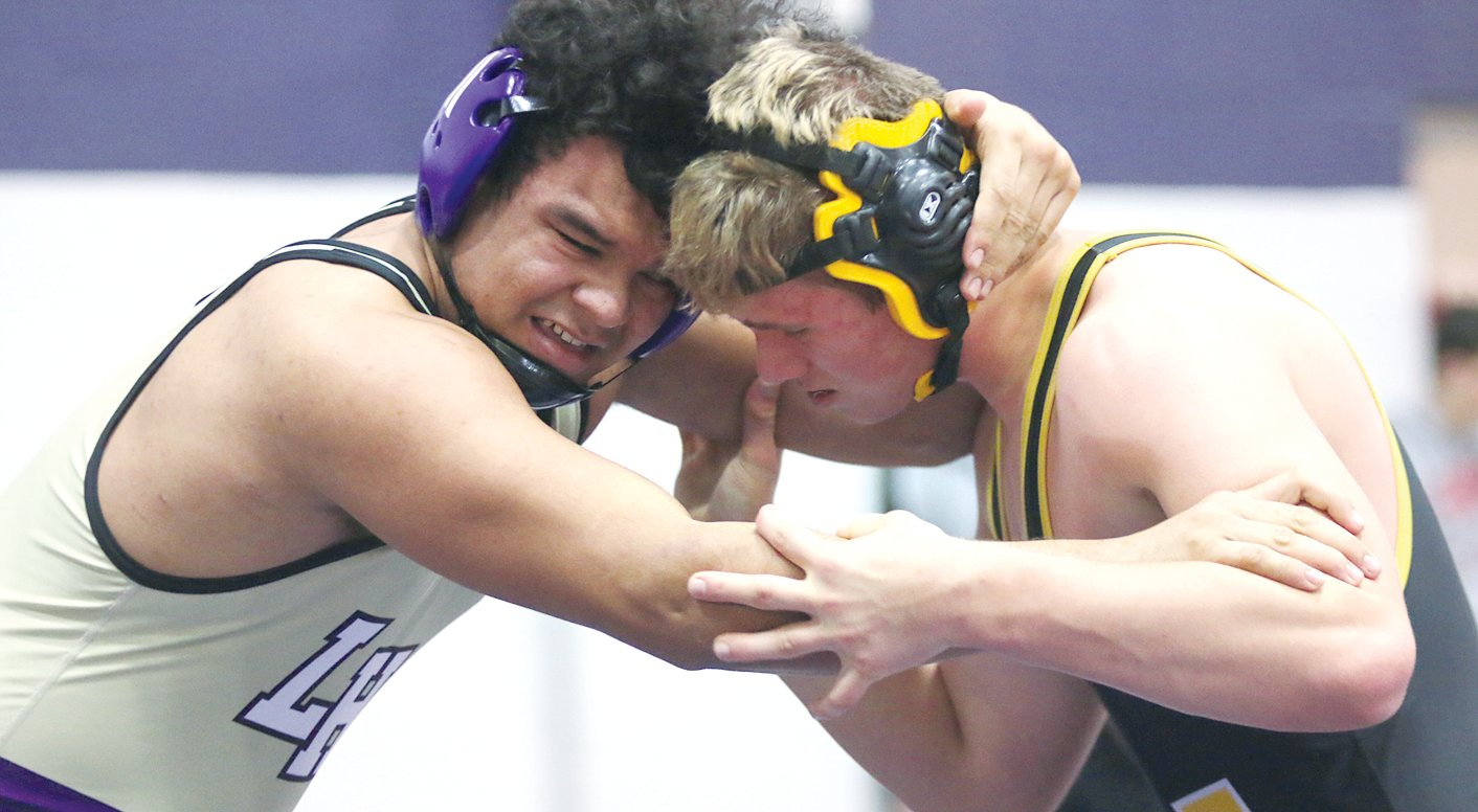 Litchfield's Jefferson Thomas (left) locks up with Brady Stitch of Lena-Winslow in the third place match at 220 pounds at the Rich Lovellette Panther Invitational on Saturday, Feb. 1. Thomas would go on to beat Stitch 5-2 to earn third place, one of six Panther medals on the day.