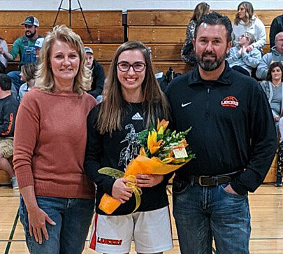 Lincolnwood senior Sydney Herman, pictured with her parents, Marla and Ty Herman, was honored prior to the start of the Lady Lancers' final home game on Friday, Feb. 7, in Raymond.