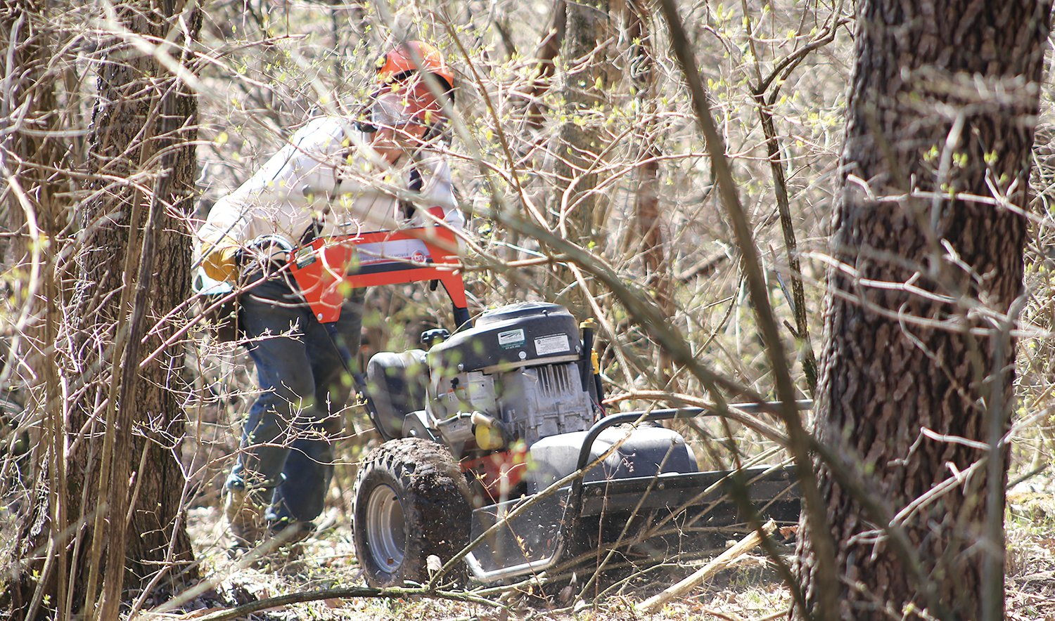 Bill Hunyadi of Plainview uses a brush mower to clear undergrowth Wednesday for a savanna area north of the barn at Bremer Sanctuary in Hillsboro.
