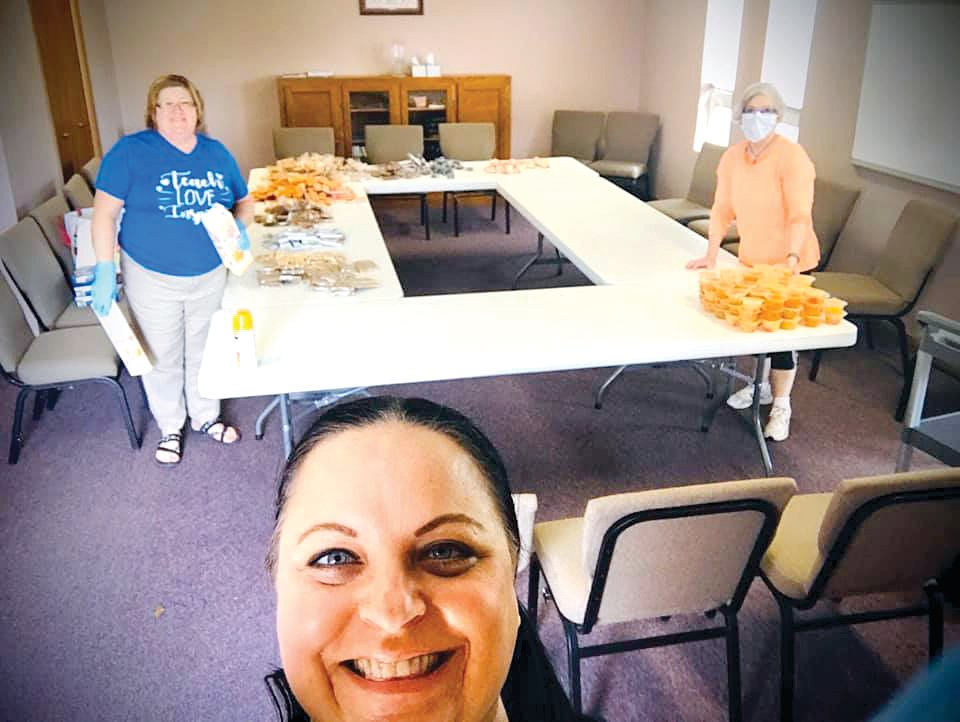 Volunteers Carol Naylor, Kyle Cameron and Robin Andrews of Hillsboro, worked hard Saturday afternoon, March 28, to fill 180 goodie bags for nursing home residents at Tremont Ridge, Hillsboro Rehabilitation and Health Care Center and Montgomery Nursing and Rehabilitation Center.