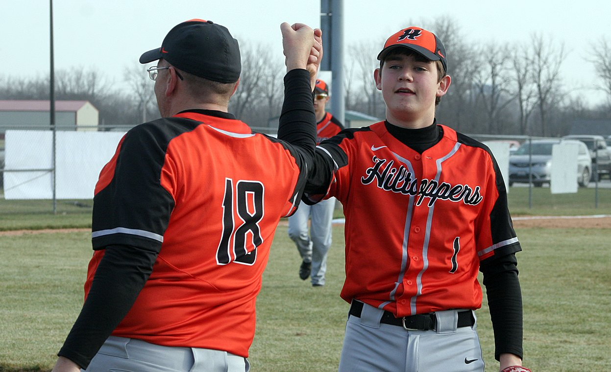 Hillsboro High School Baseball Coach Bob Allen, pictured congratulating former Topper Landon Carroll during a game in 2017, said that the connection with his players has been what he misses most during the shutdown due to COVID-19.