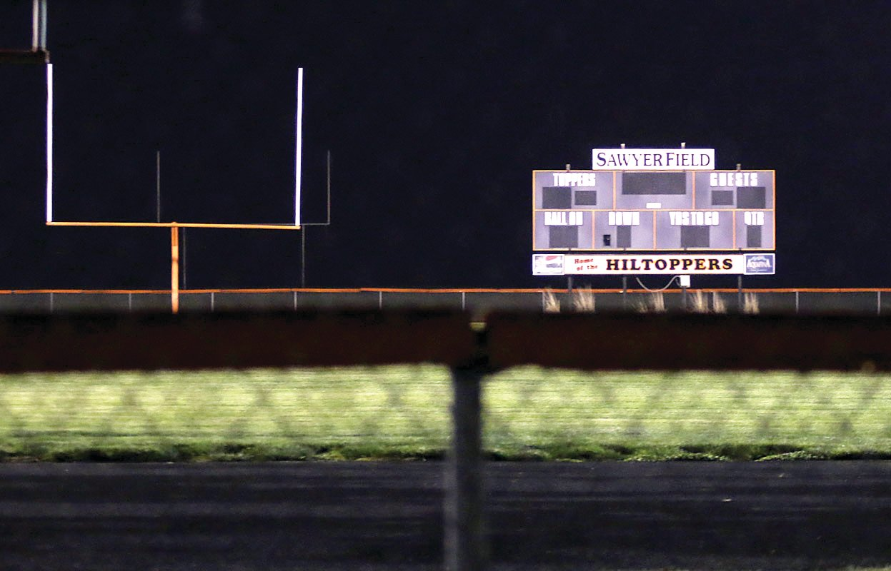 The scoreboard at Sawyer Field glowed at 8:20 p.m. Friday, April 17, as the lights were turned on at the Toppers' home turf for the Lights For The Fight show of support for the class of 2020. Dozens of cars passed by the field in honor of the seniors and those on the frontlines of the battle against COVID-19.