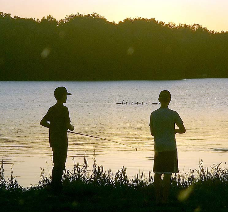 As the sun sets, grandsons Brent and Bryce make their final cast of the day at the South Marina.