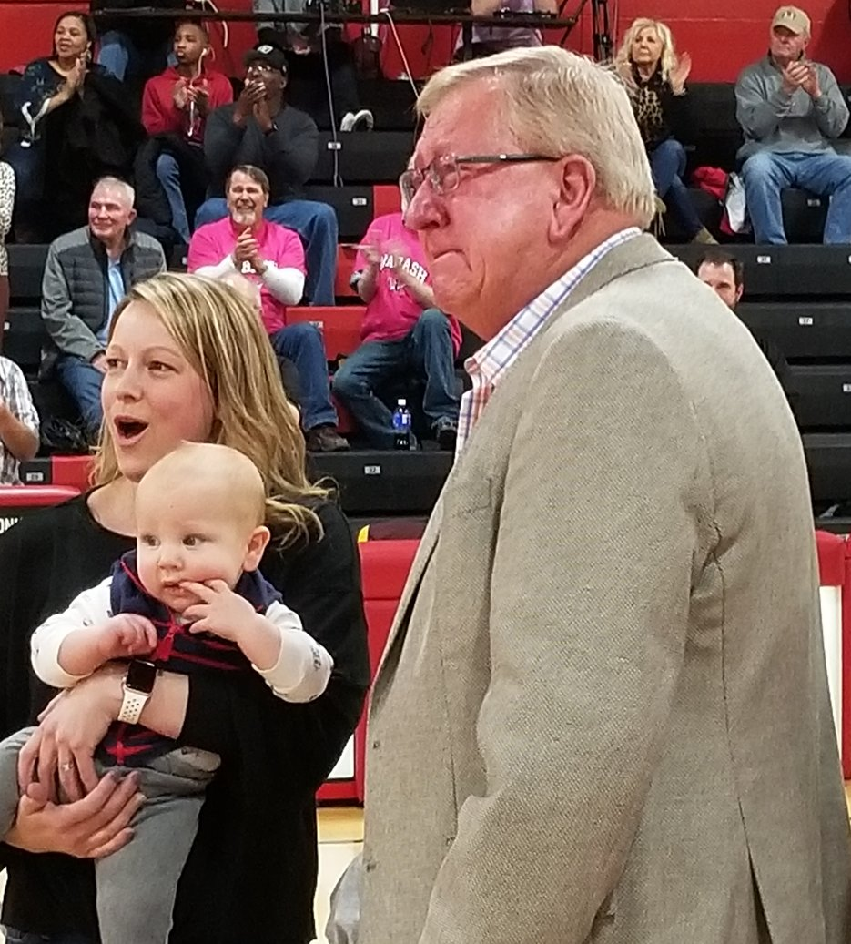 With his daughter-in-law and grandson with him, Paul Schnarre reacts to the announcement that he will be one of the initial inductees into the Wabash Valley College athletics hall of fame earlier this year. Schnarre, a Nokomis High School grad, won more than 1,400 games as softball coach at WVC and turned the Mt. Carmel junior college into a national name.